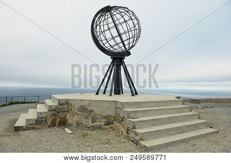 North Cape, Norway - September 05, 2011: The Symbolic Globe At The North Cape Point In A Cloudy Weat