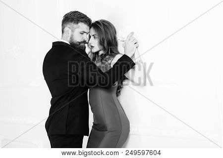 Fashion Photo Of Sexy Elegant Couple In Tender Passion. Handsome Brutal Bearded Man In Suit And Sexy