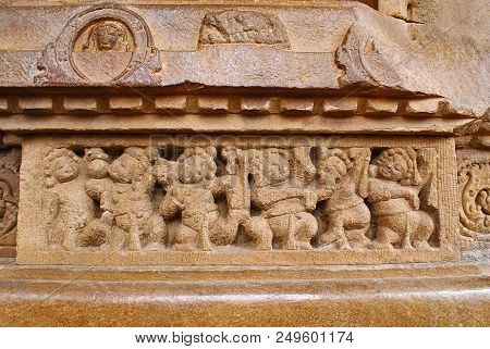 Figures of the shiva ganas servants of the lord Shiva carved on the plinth, Durga temple, Aihole, Bagalkot, Karnataka, India. The Galaganatha Group of temples. poster