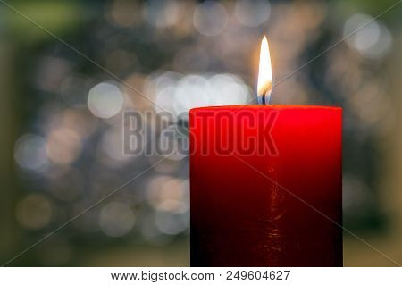 Candles Light. Christmas Candle Burning At Night. Abstract Candle Background. Golden Light Of Candle
