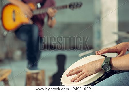Repetition of rock music band. Bass guitar player, electric guitar player and drummer at loft. Rock music and jam session concept. passion for music and youth culture concepts poster