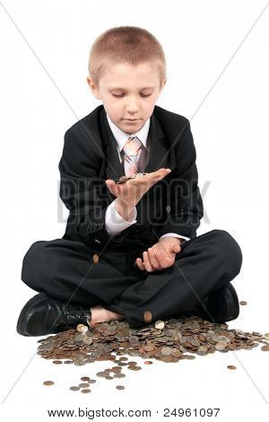 Boy in a business suit, holds money in hands, isolated on white.