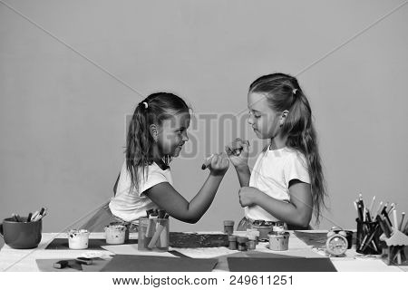 Girls With Smiling Faces By Their Art Desk With Colorful Stationery. Children Paint With Markers On