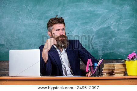 Teacher Concentrated Bearded Mature Schoolmaster Listening With Attention. Teacher Formal Wear Sit T