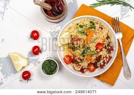 Savory Autumn Or Winter Bulgur Salad With Vegetables And Pesto Sauce On Wooden Table