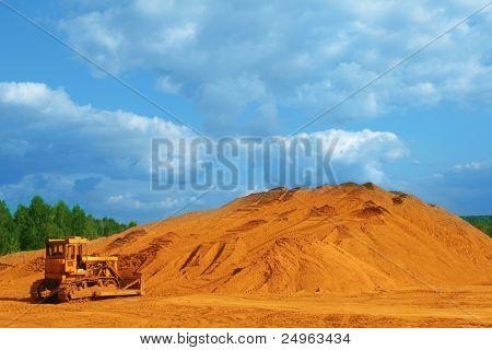 Yellow bulldozer at work site.