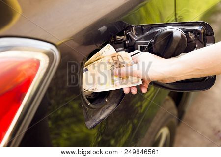Transportation Expenses Concept - Euro Money In Car Fuel Tank