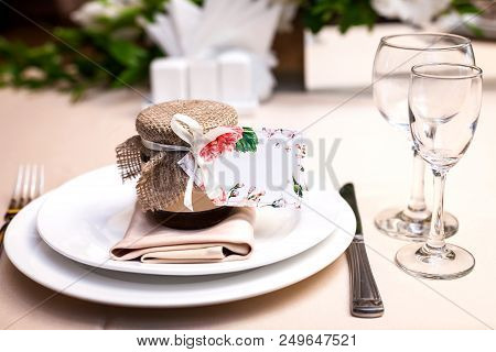 Gift Confiture Decorated With A Ribbon And A Sackcloth As A Present For Guests Standing At A Wedding