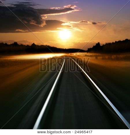 Railway in motion blur at sunset.