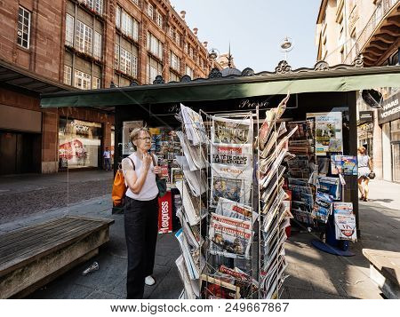 Strasbourg, France - Jul 16, 2018: Businesswoman Buying Newspaper Announcing France Champion Title A