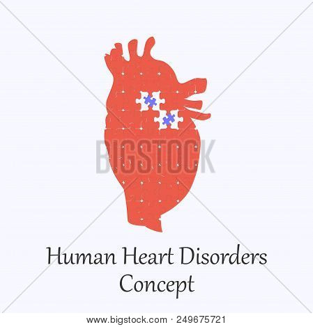 Human Heart Filled With Puzzle Pattern Few Of Whitch Unfit To The Whole. Conceptual Image Of Human H