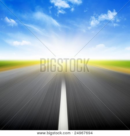 Sun,blue sky and road with motion blur.