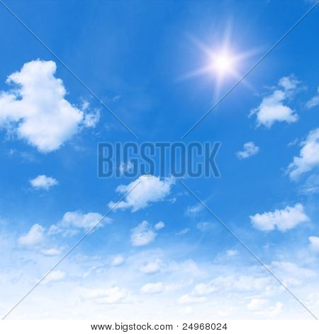 Blue sky with clouds and sun.