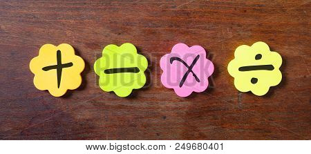 Sticky Colorful Notes In Flower Shape, Isolated, With Math Symbols On Wooden Background.