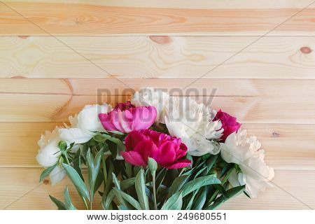Red And White Peony Flowers On Wooden Background With Copy Space For Greeting Message.