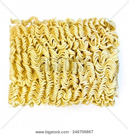 Raw Asian instant ramen noodles, isolated on white.  Top view.