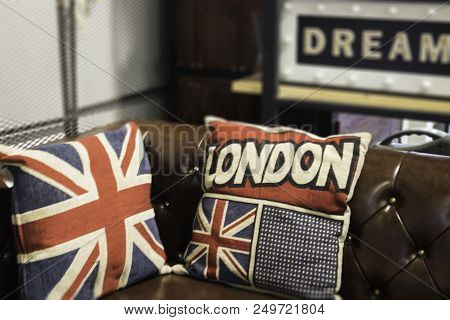 Vintage Brown Leather Sofa With Pillows, Stock Photo