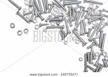 A Collection Of Iron Screws, Wood Screws And Bolts At The Right And Top Border Of A Whitebox