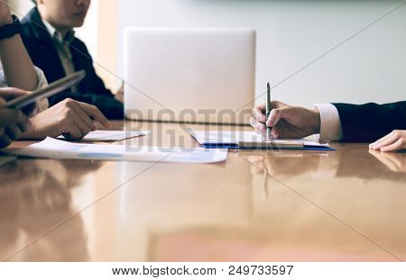 Boardroom With Human Resource Business People Writing Paper Negotiating A Contract.