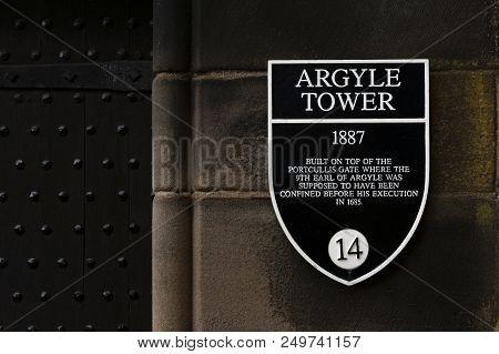 Edinburgh, Scotland - April 2018: Information Sign Of Argyle Tower On A Stone Building Wall Inside E