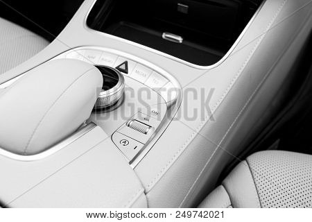 Media Volume And Navigation Control Buttons Of A Modern Car. Car Interior Details. White Leather Int