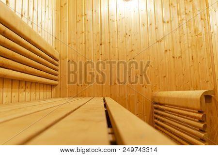Interior of Finnish sauna. Classic wooden sauna. Finnish bathroom. Wooden sauna cabin. Wooden room. Sauna steam. poster