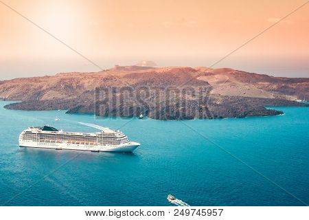Aerial View Of Modern Luxury Tourist Cruise Ship In The Bay Of Santorini, Greece