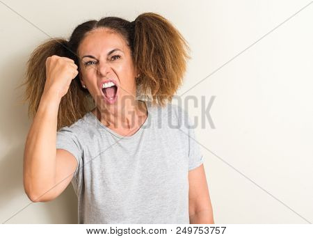 Brazilian woman wearing pigtails annoyed and frustrated shouting with anger, crazy and yelling with raised hand, anger concept poster