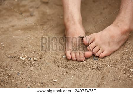 Dirty Bare Feet Of Poor Little Girl In The Street Dust, Selective Focus, Shallow Depth Of Field. Sma