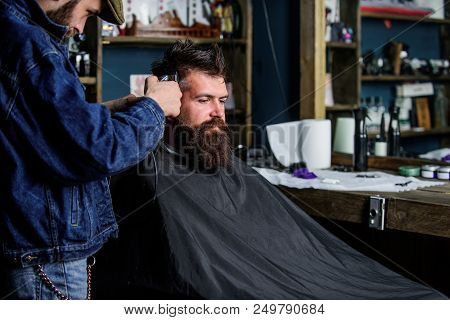 Hipster Lifestyle Concept. Hipster Client Getting Haircut. Barber With Hair Clipper Work On Hairstyl