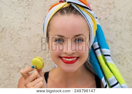Summertime - French Sweety. Young Happy Woman Is Holding A Macaron In The Hand.