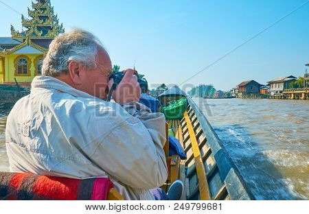 Nyaungshwe, Myanmar - February 19, 2018: The Tourist Makes Pictures From Kayak During The Trip To In