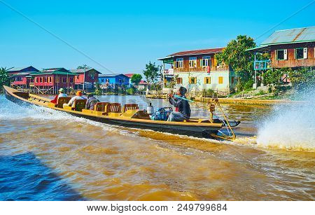 Nyaungshwe, Myanmar - February 19, 2018: The Fast Floating Kayak With Tourists On Canal Of Inle Lake