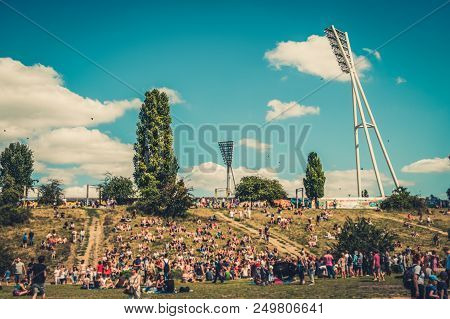 People In Park Blurry - Many People In Crowded Park (mauerpark) On A Sunny Summer Sunday In Berlin -