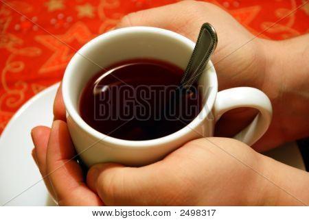 Hands Around A Cup Of Tea