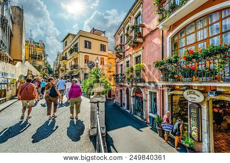 Taormina, Italy - September 14 2016: A Group Of Ladies Walk Past Shops Uphill Towards The Ancient Gr