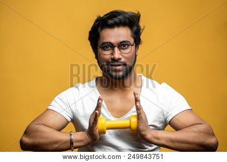 Pleasant Indian Sportsman Is Doing Exercies For Breast And Chest. Guy Is Trying To Break Dumbbell. C