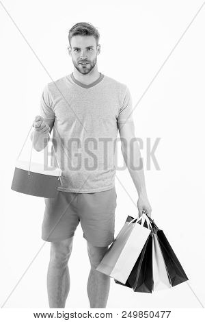 Macho With Colorful Paper Bags. Man With Shopping Bags Isolated On White. Fashion Shopper In Casual