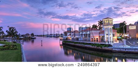 Naples, Florida, Usa - July 14, 2018: Sunset Over The Colorful Shops Of The Village On Venetian Bay