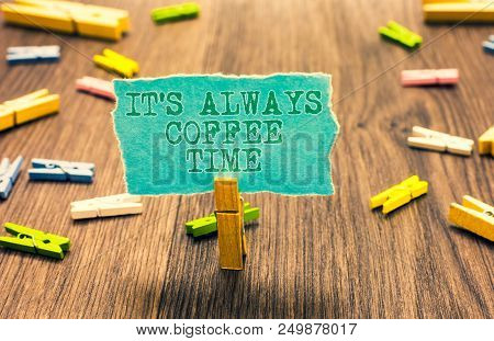 Word writing text It s is Always Coffee Time. Business concept for quote for caffeine lovers Drink all over day Clothespin holding turquoise paper note several clothespins wooden floor poster