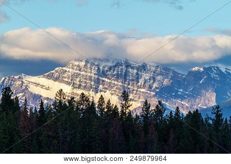 Close Up Of Mount Edith Cavell In Jasper National Park With The Glow Of The Morning Sun And Low Clou