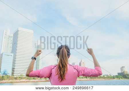 Back Shot Of Young Asian Woman Relax Herself And Warm Down After City Running Exercise With A City V