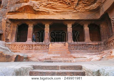Cave 3 : Carved figure of Vishnu as Narasimha, half human, half lion. Brackets of the pillars, except for one, has carvings of human figures standing under foliage in different postures, of male and female mythological characters, and an attendant figure poster