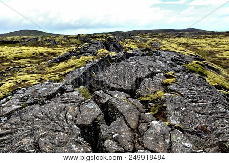 A Cracked Volcanic Lava Landscape On Iceland