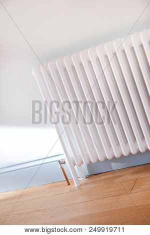 A White Radiator In A  Newly Decorated Room