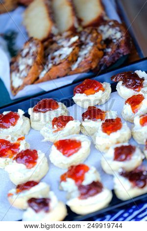 A Selection Of Afternoon Tea And Cakes Including Scones And Jam