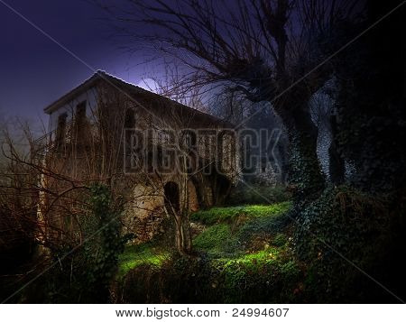 illustration of a dark haunted old house under moonlight