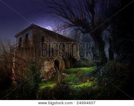 illustration of a dark haunted old house under moonlight
