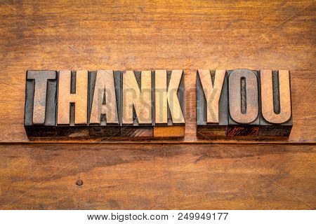 thank you - isolatedword abstract in vintage letterpress wood type blocks against grunge wooden background