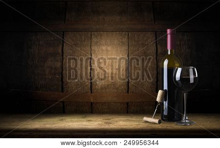 Red Wine. Wine. Bottle And Glass Of Red Wine With Ripe Grapes Still Life. Red Wine Over Black Backgr